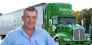 truck driver in front of Publix truck